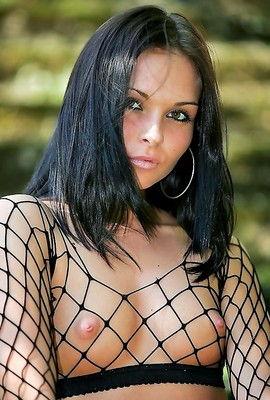 Scrumptious amateur sex kitten wears fishnet top