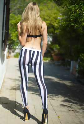 Skinny Chloe Toy wearing tight Stripey Leggings